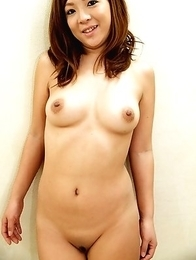 Sensual Japanese girl Kiyo slowly stripping her clothes to pose nude for the camera
